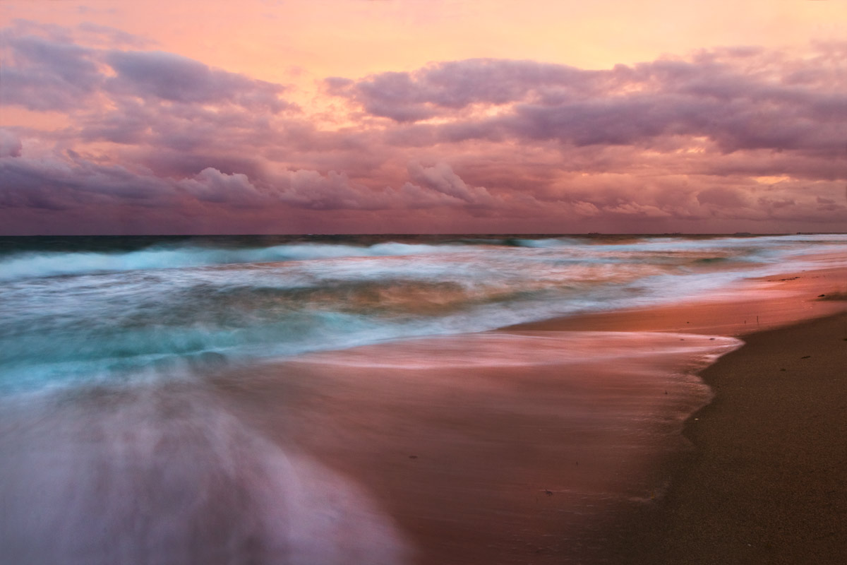 Sunset Sky Over The Beach With Long Exposure Of Ocean